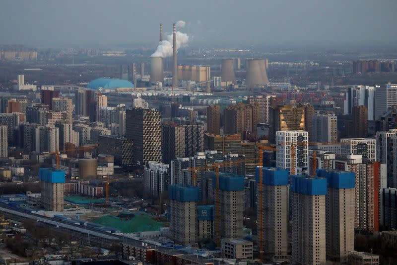 FILE PHOTO: Residential buildings under construction are seen near the central business district (CBD) in Beijing