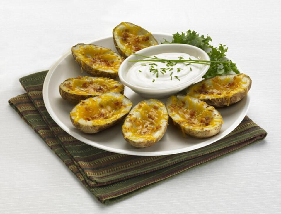 """<p><a href=""""https://www.thedailymeal.com/cook/best-cheese-recipes?referrer=yahoo&category=beauty_food&include_utm=1&utm_medium=referral&utm_source=yahoo&utm_campaign=feed"""" rel=""""nofollow noopener"""" target=""""_blank"""" data-ylk=""""slk:Cheese is always a guaranteed party pleaser"""" class=""""link rapid-noclick-resp"""">Cheese is always a guaranteed party pleaser</a>, and what better way to get the gouda times rolling than with classic potato skins? Spuds are topped with bacon, chives, sour cream and, of course, plenty of ooey, gooey melted cheese.</p> <p><a href=""""https://www.thedailymeal.com/recipes/idaho-potato-skins-recipe?referrer=yahoo&category=beauty_food&include_utm=1&utm_medium=referral&utm_source=yahoo&utm_campaign=feed"""" rel=""""nofollow noopener"""" target=""""_blank"""" data-ylk=""""slk:For the Idaho Potato Skins recipe, click here."""" class=""""link rapid-noclick-resp"""">For the Idaho Potato Skins recipe, click here.</a></p>"""