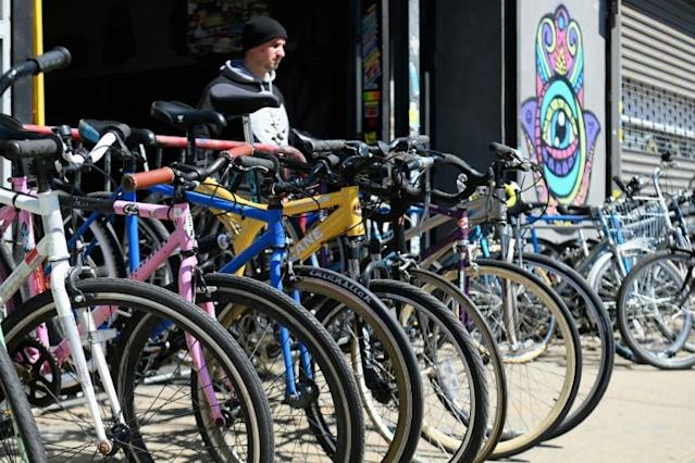 Rental bikes and bikes for purchase stand in front of a bike shop in Brooklyn, New York -- with the city shut down many workers are relying on a bicycle for the first time (AFP Photo/Angela Weiss)