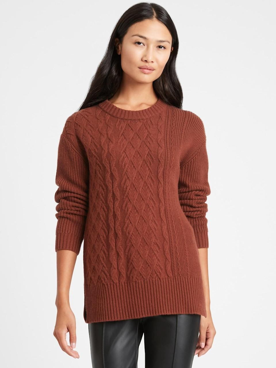<p>We love a long sweater during the holidays like this <span>Banana Republic Cable-Knit Sweater Tunic</span> ($110). A classic cable knit style it also is very forgiving <em>post</em> Thanksgiving dinner!</p>