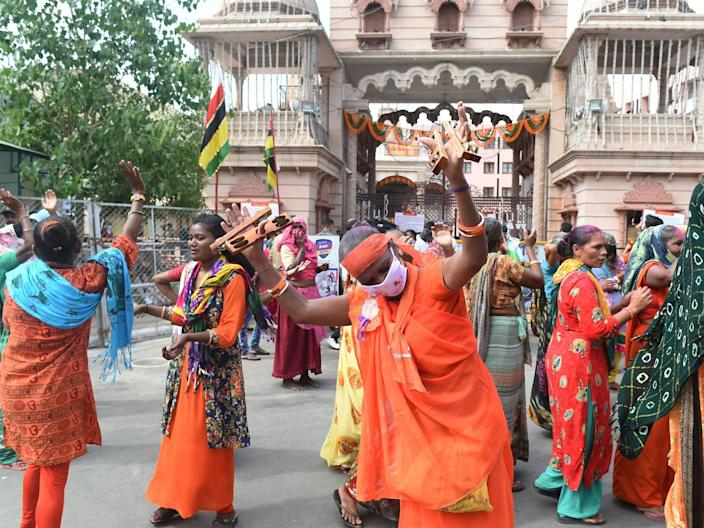 """Hindu devotees dance outside Lord Jagannath Temple in Ahmedabad, India, on June 23, 2020. <p class=""""copyright"""">SAM PANTHAKY/AFP via Getty Images</p>"""