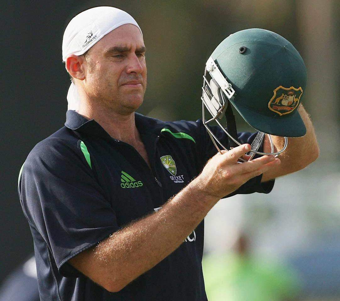 KINGSTON, SAINT VINCENT AND THE GRENADINES - MARCH 07:  Matthew Hayden of Australia adjusts his helmet after batting in the nets during training at Sion Hill Cricket Ground on March 7, 2007, in Kingston, St Vincent.  (Photo by Hamish Blair/Getty Images)
