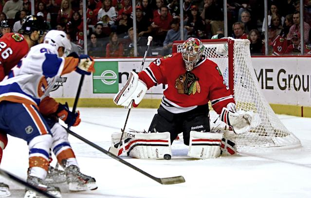 Chicago Blackhawks goalie Nikolai Khabibulin makes save during the first period of an NHL hockey game against the New York Islanders in Chicago on Friday, Oct. 11, 2013. (AP Photo/Charles Cherney)