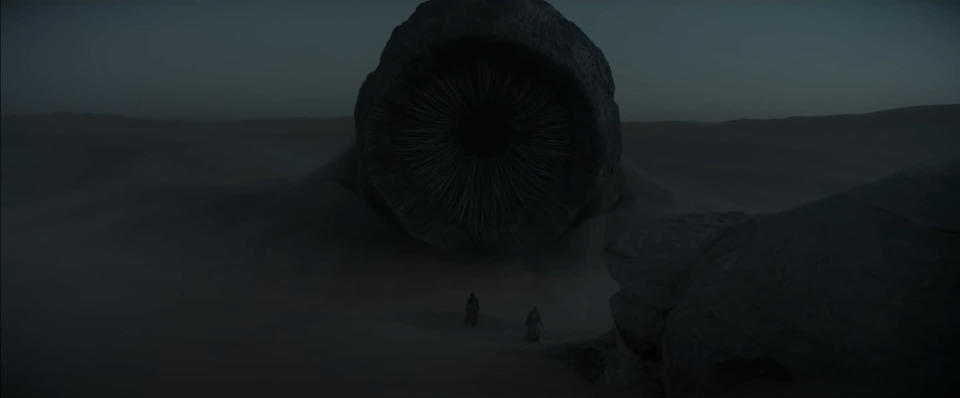A sandworm looms over Paul and Jessica