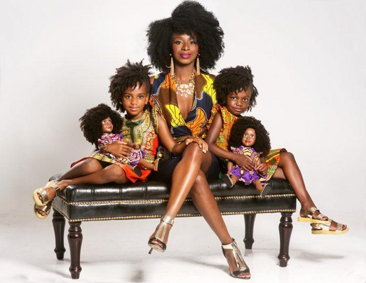 Mushiya, center, pictured with her daughters Kasai Tshikuka-Smith (L), Keleshe Tshikuka-Smith (R) and their dolls. (Photo: Drexina Nelson Photography)