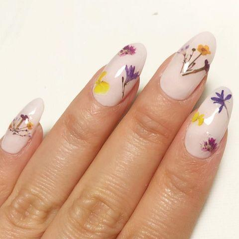 """<p>As an ode to the flowers chosen for your own bouquet, stay on brand by getting your manicurist to hand paint the blooms onto your nails.</p><p><a href=""""https://www.instagram.com/p/Bw2Ici3BMOU/"""" rel=""""nofollow noopener"""" target=""""_blank"""" data-ylk=""""slk:See the original post on Instagram"""" class=""""link rapid-noclick-resp"""">See the original post on Instagram</a></p>"""