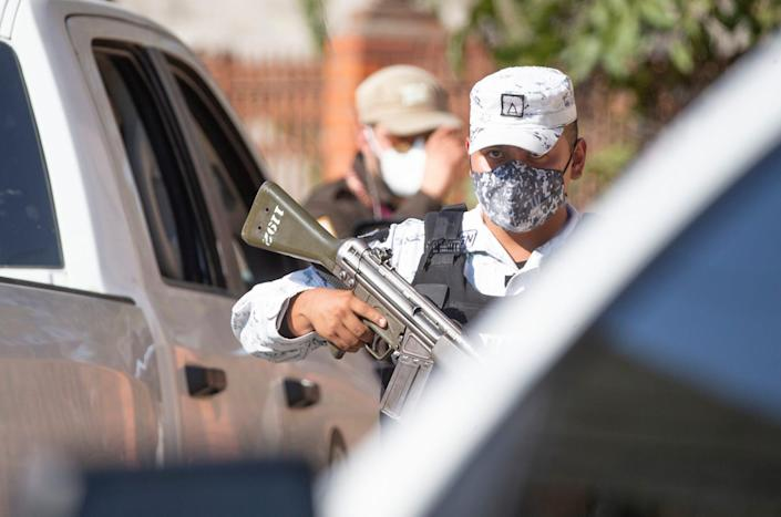 Mexican National Guard troops provide support for Mexican Immigration as they detain Haitian migrants in the the city of Ciudad Acuna during random street sweep on Sept. 20, 2021.