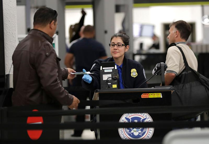 Many TSA agents have had to report to work without being paid throughout the shutdown. It will take an act of Congress to give those workers backpay once the government reopens. (Photo: ASSOCIATED PRESS)