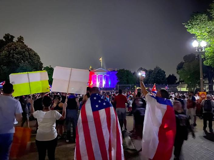 Thousands of protesters gather outside the White House to mark the 26th of July national holiday in Cuba. The protesters were calling on President Joe Biden to increase pressure on Cuba after historic pro-democracy protests on the island.