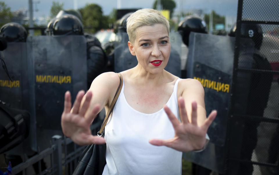 FILE - In this Sunday, Aug. 30, 2020 file photo, Maria Kolesnikova, one of Belarus' opposition leaders, gestures during a rally in Minsk, Belarus. Belarus President Alexander Lukashenko has relied on massive arrests and intimidation tactics to hold on to power despite nearly three months of protests sparked by his re-election to a sixth term, but continuing protests have cast an unprecedented challenge to his 26-year rule. (Tut.By via AP, File)