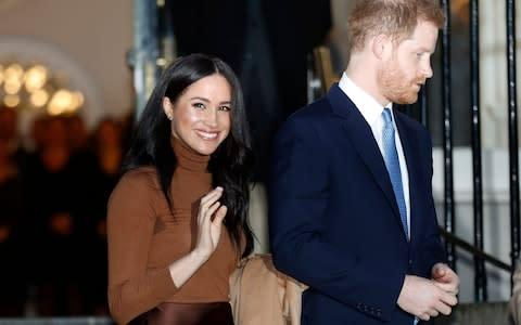 <span>The Duke and Duchess of Sussex during their last public engagement before they announced they were stepping back as senior royals</span> <span>Credit: A{ </span>