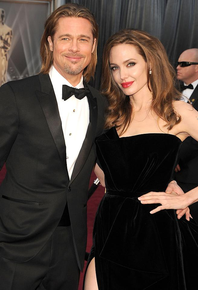 "<b>Brad Pitt & Angelina Jolie</b><br>Saving the best for last, Brad finally put a ring on it! Angelina Jolie, 36, and Brad Pitt, 48, have been together since around the time they met on the set of ""Mr. & Mrs. Smith"" (2005). Seven years and six kids later, <a href=""http://omg.yahoo.com/news/pic-angelina-jolie-smiles-flashes-huge-engagement-ring-161500491.html"">the mega-famous couple are now engaged.</a>"
