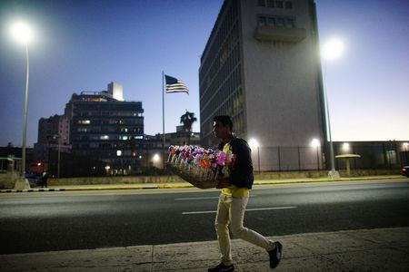 A man selling sweets passes by in front of the U.S. Embassy in Havana, Cuba, January 12, 2017. REUTERS/Alexandre Meneghini