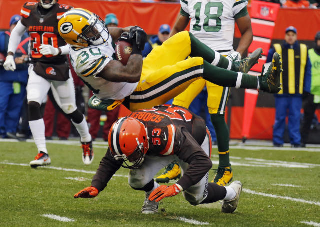 <p>Green Bay Packers running back Jamaal Williams (30) is upended by Cleveland Browns outside linebacker Joe Schobert (53) in the second half of an NFL football game, Sunday, Dec. 10, 2017, in Cleveland. (AP Photo/Ron Schwane) </p>