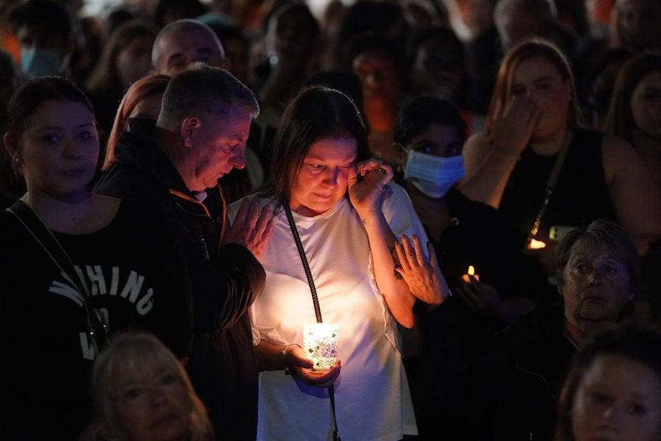 Members of the public attend a vigil in memory of Sabina Nessa at Pegler Square in Kidbrooke (Jonathan Brady/PA) (PA Wire)
