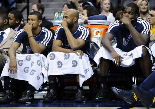 From left to right, Utah Jazz guard Earl Watson, Jamaal Tinsley and Paul Millsap look on in the final minutes of the fourth quarter of an NBA basketball game against the Denver Nuggets, Saturday, Jan. 5, 2013, in Denver. Denver defeated Utah 110-91. (AP Photo/Jack Dempsey)