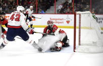 Washington Capitals right wing Tom Wilson (43) watches his goal go into the net against Ottawa Senators goaltender Marcus Hogberg (35) during the first period of an NHL hockey game, Saturday, Dec. 29, 2018 in Ottawa, Ontario. (Justin Tang/The Canadian Press via AP)