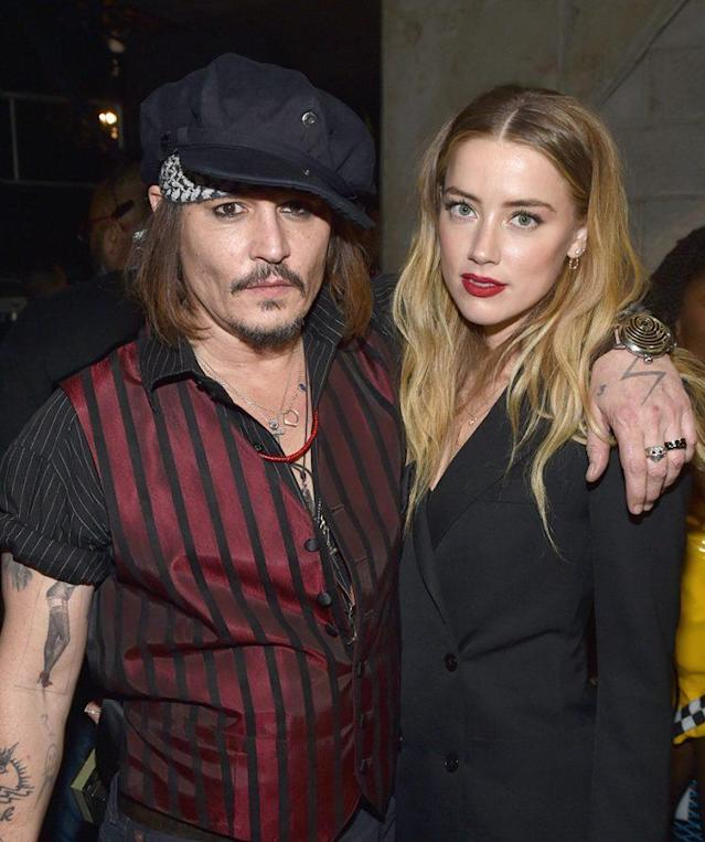 Happier times: Johnny Depp and Amber Heard at the Grammys. (Photo: John Shearer/WireImage)