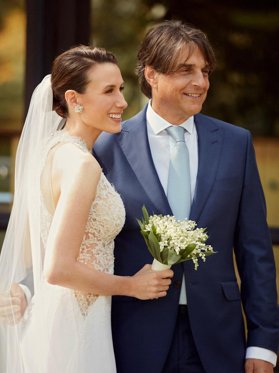 """The lace on my dress was covered with seed pearls and had the lyrics from our song inscribed that read, """"Let's Fall In Love"""" in such delicate letters that only I knew. Robert's suit is from his longtime friend and tailor, Nigel Curtiss. I also surprised Robert by having his tailor embroider a secret message inside his jacket."""