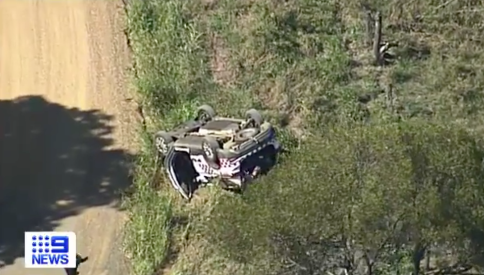 A police car on the way to the scene of the crash rolled, though no officers were injured. Source: Nine News