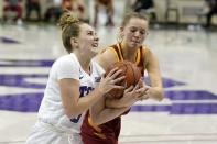 TCU guard Caroline Germond (0) loses control of the ball to Iowa State guard Aubrey Joens (20) on a drive to the basket in the second half of an NCAA college basketball game in Fort Worth, Texas, Wednesday, Dec. 2, 2020. (AP Photo/Tony Gutierrez)