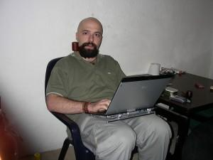 Bald guy on a laptop