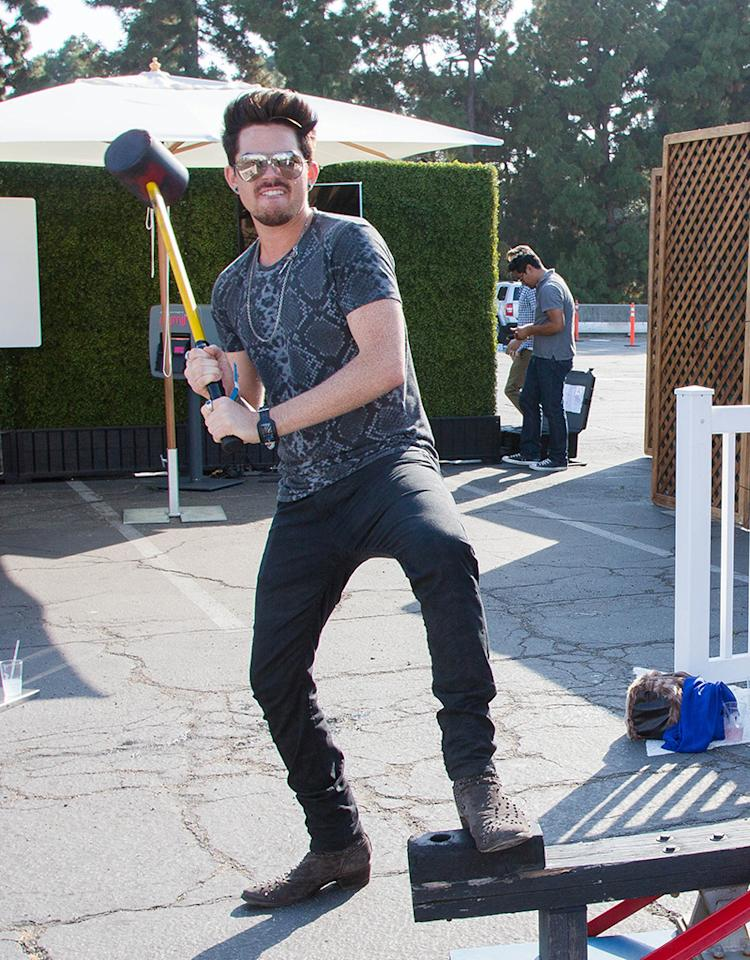"""American Idol"" alum Adam Lambert showed his strength at Just Jared's Summer Kickoff Party presented by McDonald's in Los Angeles over the weekend. (6/1/2013) <!--[if gte mso 9]><xml> <w:LatentStyles DefLockedState=""false"" DefUnhideWhenUsed=""true""  DefSemiHidden=""true"" DefQFormat=""false"" DefPriority=""99""  LatentStyleCount=""267"">  <w:LsdException Locked=""false"" Priority=""0"" SemiHidden=""false""   UnhideWhenUsed=""false"" QFormat=""true"" Name=""Normal""/>  <w:LsdException Locked=""false"" Priority=""9"" SemiHidden=""false""   UnhideWhenUsed=""false"" QFormat=""true"" Name=""heading 1""/>  <w:LsdException Locked=""false"" Priority=""9"" QFormat=""true"" Name=""heading 2""/>  <w:LsdException Locked=""false"" Priority=""9"" QFormat=""true"" Name=""heading 3""/>  <w:LsdException Locked=""false"" Priority=""9"" QFormat=""true"" Name=""heading 4""/>  <w:LsdException Locked=""false"" Priority=""9"" QFormat=""true"" Name=""heading 5""/>  <w:LsdException Locked=""false"" Priority=""9"" QFormat=""true"" Name=""heading 6""/>  <w:LsdException Locked=""false"" Priority=""9"" QFormat=""true"" Name=""heading 7""/>  <w:LsdException Locked=""false"" Priority=""9"" QFormat=""true"" Name=""heading 8""/>  <w:LsdException Locked=""false"" Priority=""9"" QFormat=""true"" Name=""heading 9""/>  <w:LsdException Locked=""false"" Priority=""39"" Name=""toc 1""/>  <w:LsdException Locked=""false"" Priority=""39"" Name=""toc 2""/>  <w:LsdException Locked=""false"" Priority=""39"" Name=""toc 3""/>  <w:LsdException Locked=""false"" Priority=""39"" Name=""toc 4""/>  <w:LsdException Locked=""false"" Priority=""39"" Name=""toc 5""/>  <w:LsdException Locked=""false"" Priority=""39"" Name=""toc 6""/>  <w:LsdException Locked=""false"" Priority=""39"" Name=""toc 7""/>  <w:LsdException Locked=""false"" Priority=""39"" Name=""toc 8""/>  <w:LsdException Locked=""false"" Priority=""39"" Name=""toc 9""/>  <w:LsdException Locked=""false"" Priority=""35"" QFormat=""true"" Name=""caption""/>  <w:LsdException Locked=""false"" Priority=""10"" SemiHidden=""false""   UnhideWhenUsed=""false"" QFormat=""true"" Name=""Title""/>  <w:LsdException Locked=""false"" Priority=""1"" Name=""Default Paragraph Font""/>  <w:LsdException Locked=""false"" Priority=""11"" SemiHidden=""false""   UnhideWhenUsed=""false"" QFormat=""true"" Name=""Subtitle""/>  <w:LsdException Locked=""false"" Priority=""22"" SemiHidden=""false""   UnhideWhenUsed=""false"" QFormat=""true"" Name=""Strong""/>  <w:LsdException Locked=""false"" Priority=""20"" SemiHidden=""false""   UnhideWhenUsed=""false"" QFormat=""true"" Name=""Emphasis""/>  <w:LsdException Locked=""false"" Priority=""59"" SemiHidden=""false""   UnhideWhenUsed=""false"" Name=""Table Grid""/>  <w:LsdException Locked=""false"" UnhideWhenUsed=""false"" Name=""Placeholder Text""/>  <w:LsdException Locked=""false"" Priority=""1"" SemiHidden=""false""   UnhideWhenUsed=""false"" QFormat=""true"" Name=""No Spacing""/>  <w:LsdException Locked=""false"" Priority=""60"" SemiHidden=""false""   UnhideWhenUsed=""false"" Name=""Light Shading""/>  <w:LsdException Locked=""false"" Priority=""61"" SemiHidden=""false""   UnhideWhenUsed=""false"" Name=""Light List""/>  <w:LsdException Locked=""false"" Priority=""62"" SemiHidden=""false""   UnhideWhenUsed=""false"" Name=""Light Grid""/>  <w:LsdException Locked=""false"" Priority=""63"" SemiHidden=""false""   UnhideWhenUsed=""false"" Name=""Medium Shading 1""/>  <w:LsdException Locked=""false"" Priority=""64"" SemiHidden=""false""   UnhideWhenUsed=""false"" Name=""Medium Shading 2""/>  <w:LsdException Locked=""false"" Priority=""65"" SemiHidden=""false""   UnhideWhenUsed=""false"" Name=""Medium List 1""/>  <w:LsdException Locked=""false"" Priority=""66"" SemiHidden=""false""   UnhideWhenUsed=""false"" Name=""Medium List 2""/>  <w:LsdException Locked=""false"" Priority=""67"" SemiHidden=""false""   UnhideWhenUsed=""false"" Name=""Medium Grid 1""/>  <w:LsdException Locked=""false"" Priority=""68"" SemiHidden=""false""   UnhideWhenUsed=""false"" Name=""Medium Grid 2""/>  <w:LsdException Locked=""false"" Priority=""69"" SemiHidden=""false""   UnhideWhenUsed=""false"" Name=""Medium Grid 3""/>  <w:LsdException Locked=""false"" Priority=""70"" SemiHidden=""false""   UnhideWhenUsed=""false"" Name=""Dark List""/>  <w:LsdException Locked=""false"" Priority=""71"" SemiHidden=""false""   UnhideWhenUsed=""false"" Name=""Colorful Shading""/>  <w:LsdException Locked=""false"" Priority=""72"" SemiHidden=""false""   UnhideWhenUsed=""false"" Name=""Colorful List""/>  <w:LsdException Locked=""false"" Priority=""73"" SemiHidden=""false""   UnhideWhenUsed=""false"" Name=""Colorful Grid""/>  <w:LsdException Locked=""false"" Priority=""60"" SemiHidden=""false""   UnhideWhenUsed=""false"" Name=""Light Shading Accent 1""/>  <w:LsdException Locked=""false"" Priority=""61"" SemiHidden=""false""   UnhideWhenUsed=""false"" Name=""Light List Accent 1""/>  <w:LsdException Locked=""false"" Priority=""62"" SemiHidden=""false""   UnhideWhenUsed=""false"" Name=""Light Grid Accent 1""/>  <w:LsdException Locked=""false"" Priority=""63"" SemiHidden=""false""   UnhideWhenUsed=""false"" Name=""Medium Shading 1 Accent 1""/>  <w:LsdException Locked=""false"" Priority=""64"" SemiHidden=""false""   UnhideWhenUsed=""false"" Name=""Medium Shading 2 Accent 1""/>  <w:LsdException Locked=""false"" Priority=""65"" SemiHidden=""false""   UnhideWhenUsed=""false"" Name=""Medium List 1 Accent 1""/>  <w:LsdException Locked=""false"" UnhideWhenUsed=""false"" Name=""Revision""/>  <w:LsdException Locked=""false"" Priority=""34"" SemiHidden=""false""   UnhideWhenUsed=""false"" QFormat=""true"" Name=""List Paragraph""/>  <w:LsdException Locked=""false"" Priority=""29"" SemiHidden=""false""   UnhideWhenUsed=""false"" QFormat=""true"" Name=""Quote""/>  <w:LsdException Locked=""false"" Priority=""30"" SemiHidden=""false""   UnhideWhenUsed=""false"" QFormat=""true"" Name=""Intense Quote""/>  <w:LsdException Locked=""false"" Priority=""66"" SemiHidden=""false""   UnhideWhenUsed=""false"" Name=""Medium List 2 Accent 1""/>  <w:LsdException Locked=""false"" Priority=""67"" SemiHidden=""false""   UnhideWhenUsed=""false"" Name=""Medium Grid 1 Accent 1""/>  <w:LsdException Locked=""false"" Priority=""68"" SemiHidden=""false""   UnhideWhenUsed=""false"" Name=""Medium Grid 2 Accent 1""/>  <w:LsdException Locked=""false"" Priority=""69"" SemiHidden=""false""   UnhideWhenUsed=""false"" Name=""Medium Grid 3 Accent 1""/>  <w:LsdException Locked=""false"" Priority=""70"" SemiHidden=""false""   UnhideWhenUsed=""false"" Name=""Dark List Accent 1""/>  <w:LsdException Locked=""false"" Priority=""71"" SemiHidden=""false""   UnhideWhenUsed=""false"" Name=""Colorful Shading Accent 1""/>  <w:LsdException Locked=""false"" Priority=""72"" SemiHidden=""false""   UnhideWhenUsed=""false"" Name=""Colorful List Accent 1""/>  <w:LsdException Locked=""false"" Priority=""73"" SemiHidden=""false""   UnhideWhenUsed=""false"" Name=""Colorful Grid Accent 1""/>  <w:LsdException Locked=""false"" Priority=""60"" SemiHidden=""false""   UnhideWhenUsed=""false"" Name=""Light Shading Accent 2""/>  <w:LsdException Locked=""false"" Priority=""61"" SemiHidden=""false""   UnhideWhenUsed=""false"" Name=""Light List Accent 2""/>  <w:LsdException Locked=""false"" Priority=""62"" SemiHidden=""false""   UnhideWhenUsed=""false"" Name=""Light Grid Accent 2""/>  <w:LsdException Locked=""false"" Priority=""63"" SemiHidden=""false""   UnhideWhenUsed=""false"" Name=""Medium Shading 1 Accent 2""/>  <w:LsdException Locked=""false"" Priority=""64"" SemiHidden=""false""   UnhideWhenUsed=""false"" Name=""Medium Shading 2 Accent 2""/>  <w:LsdException Locked=""false"" Priority=""65"" SemiHidden=""false""   UnhideWhenUsed=""false"" Name=""Medium List 1 Accent 2""/>  <w:LsdException Locked=""false"" Priority=""66"" SemiHidden=""false""   UnhideWhenUsed=""false"" Name=""Medium List 2 Accent 2""/>  <w:LsdException Locked=""false"" Priority=""67"" SemiHidden=""false""   UnhideWhenUsed=""false"" Name=""Medium Grid 1 Accent 2""/>  <w:LsdException Locked=""false"" Priority=""68"" SemiHidden=""false""   UnhideWhenUsed=""false"" Name=""Medium Grid 2 Accent 2""/>  <w:LsdException Locked=""false"" Priority=""69"" SemiHidden=""false""   UnhideWhenUsed=""false"" Name=""Medium Grid 3 Accent 2""/>  <w:LsdException Locked=""false"" Priority=""70"" SemiHidden=""false""   UnhideWhenUsed=""false"" Name=""Dark List Accent 2""/>  <w:LsdException Locked=""false"" Priority=""71"" SemiHidden=""false""   UnhideWhenUsed=""false"" Name=""Colorful Shading Accent 2""/>  <w:LsdException Locked=""false"" Priority=""72"" SemiHidden=""false""   UnhideWhenUsed=""false"" Name=""Colorful List Accent 2""/>  <w:LsdException Locked=""false"" Priority=""73"" SemiHidden=""false""   UnhideWhenUsed=""false"" Name=""Colorful Grid Accent 2""/>  <w:LsdException Locked=""false"" Priority=""60"" SemiHidden=""false""   UnhideWhenUsed=""false"" Name=""Light Shading Accent 3""/>  <w:LsdException Locked=""false"" Priority=""61"" SemiHidden=""false""   UnhideWhenUsed=""false"" Name=""Light List Accent 3""/>  <w:LsdException Locked=""false"" Priority=""62"" SemiHidden=""false""   UnhideWhenUsed=""false"" Name=""Light Grid Accent 3""/>  <w:LsdException Locked=""false"" Priority=""63"" SemiHidden=""false""   UnhideWhenUsed=""false"" Name=""Medium Shading 1 Accent 3""/>  <w:LsdException Locked=""false"" Priority=""64"" SemiHidden=""false""   UnhideWhenUsed=""false"" Name=""Medium Shading 2 Accent 3""/>  <w:LsdException Locked=""false"" Priority=""65"" SemiHidden=""false""   UnhideWhenUsed=""false"" Name=""Medium List 1 Accent 3""/>  <w:LsdException Locked=""false"" Priority=""66"" SemiHidden=""false""   UnhideWhenUsed=""false"" Name=""Medium List 2 Accent 3""/>  <w:LsdException Locked=""false"" Priority=""67"" SemiHidden=""false""   UnhideWhenUsed=""false"" Name=""Medium Grid 1 Accent 3""/>  <w:LsdException Locked=""false"" Priority=""68"" SemiHidden=""false""   UnhideWhenUsed=""false"" Name=""Medium Grid 2 Accent 3""/>  <w:LsdException Locked=""false"" Priority=""69"" SemiHidden=""false""   UnhideWhenUsed=""false"" Name=""Medium Grid 3 Accent 3""/>  <w:LsdException Locked=""false"" Priority=""70"" SemiHidden=""false""   UnhideWhenUsed=""false"" Name=""Dark List Accent 3""/>  <w:LsdException Locked=""false"" Priority=""71"" SemiHidden=""false""   UnhideWhenUsed=""false"" Name=""Colorful Shading Accent 3""/>  <w:LsdException Locked=""false"" Priority=""72"" SemiHidden=""false""   UnhideWhenUsed=""false"" Name=""Colorful List Accent 3""/>  <w:LsdException Locked=""false"" Priority=""73"" SemiHidden=""false""   UnhideWhenUsed=""false"" Name=""Colorful Grid Accent 3""/>  <w:LsdException Locked=""false"" Priority=""60"" SemiHidden=""false""   UnhideWhenUsed=""false"" Name=""Light Shading Accent 4""/>  <w:LsdException Locked=""false"" Priority=""61"" SemiHidden=""false""   UnhideWhenUsed=""false"" Name=""Light List Accent 4""/>  <w:LsdException Locked=""false"" Priority=""62"" SemiHidden=""false""   UnhideWhenUsed=""false"" Name=""Light Grid Accent 4""/>  <w:LsdException Locked=""false"" Priority=""63"" SemiHidden=""false""   UnhideWhenUsed=""false"" Name=""Medium Shading 1 Accent 4""/>  <w:LsdException Locked=""false"" Priority=""64"" SemiHidden=""false""   UnhideWhenUsed=""false"" Name=""Medium Shading 2 Accent 4""/>  <w:LsdException Locked=""false"" Priority=""65"" SemiHidden=""false""   UnhideWhenUsed=""false"" Name=""Medium List 1 Accent 4""/>  <w:LsdException Locked=""false"" Priority=""66"" SemiHidden=""false""   UnhideWhenUsed=""false"" Name=""Medium List 2 Accent 4""/>  <w:LsdException Locked=""false"" Priority=""67"" SemiHidden=""false""   UnhideWhenUsed=""false"" Name=""Medium Grid 1 Accent 4""/>  <w:LsdException Locked=""false"" Priority=""68"" SemiHidden=""false""   UnhideWhenUsed=""false"" Name=""Medium Grid 2 Accent 4""/>  <w:LsdException Locked=""false"" Priority=""69"" SemiHidden=""false""   UnhideWhenUsed=""false"" Name=""Medium Grid 3 Accent 4""/>  <w:LsdException Locked=""false"" Priority=""70"" SemiHidden=""false""   UnhideWhenUsed=""false"" Name=""Dark List Accent 4""/>  <w:LsdException Locked=""false"" Priority=""71"" SemiHidden=""false""   UnhideWhenUsed=""false"" Name=""Colorful Shading Accent 4""/>  <w:LsdException Locked=""false"" Priority=""72"" SemiHidden=""false""   UnhideWhenUsed=""false"" Name=""Colorful List Accent 4""/>  <w:LsdException Locked=""false"" Priority=""73"" SemiHidden=""false""   UnhideWhenUsed=""false"" Name=""Colorful Grid Accent 4""/>  <w:LsdException Locked=""false"" Priority=""60"" SemiHidden=""false""   UnhideWhenUsed=""false"" Name=""Light Shading Accent 5""/>  <w:LsdException Locked=""false"" Priority=""61"" SemiHidden=""false""   UnhideWhenUsed=""false"" Name=""Light List Accent 5""/>  <w:LsdException Locked=""false"" Priority=""62"" SemiHidden=""false""   UnhideWhenUsed=""false"" Name=""Light Grid Accent 5""/>  <w:LsdException Locked=""false"" Priority=""63"" SemiHidden=""false""   UnhideWhenUsed=""false"" Name=""Medium Shading 1 Accent 5""/>  <w:LsdException Locked=""false"" Priority=""64"" SemiHidden=""false""   UnhideWhenUsed=""false"" Name=""Medium Shading 2 Accent 5""/>  <w:LsdException Locked=""false"" Priority=""65"" SemiHidden=""false""   UnhideWhenUsed=""false"" Name=""Medium List 1 Accent 5""/>  <w:LsdException Locked=""false"" Priority=""66"" SemiHidden=""false""   UnhideWhenUsed=""false"" Name=""Medium List 2 Accent 5""/>  <w:LsdException Locked=""false"" Priority=""67"" SemiHidden=""false""   UnhideWhenUsed=""false"" Name=""Medium Grid 1 Accent 5""/>  <w:LsdException Locked=""false"" Priority=""68"" SemiHidden=""false""   UnhideWhenUsed=""false"" Name=""Medium Grid 2 Accent 5""/>  <w:LsdException Locked=""false"" Priority=""69"" SemiHidden=""false""   UnhideWhenUsed=""false"" Name=""Medium Grid 3 Accent 5""/>  <w:LsdException Locked=""false"" Priority=""70"" SemiHidden=""false""   UnhideWhenUsed=""false"" Name=""Dark List Accent 5""/>  <w:LsdException Locked=""false"" Priority=""71"" SemiHidden=""false""   UnhideWhenUsed=""false"" Name=""Colorful Shading Accent 5""/>  <w:LsdException Locked=""false"" Priority=""72"" SemiHidden=""false""   UnhideWhenUsed=""false"" Name=""Colorful List Accent 5""/>  <w:LsdException Locked=""false"" Priority=""73"" SemiHidden=""false""   UnhideWhenUsed=""false"" Name=""Colorful Grid Accent 5""/>  <w:LsdException Locked=""false"" Priority=""60"" SemiHidden=""false""   UnhideWhenUsed=""false"" Name=""Light Shading Accent 6""/>  <w:LsdException Locked=""false"" Priority=""61"" SemiHidden=""false""   UnhideWhenUsed=""false"" Name=""Light List Accent 6""/>  <w:LsdException Locked=""false"" Priority=""62"" SemiHidden=""false""   UnhideWhenUsed=""false"" Name=""Light Grid Accent 6""/>  <w:LsdException Locked=""false"" Priority=""63"" SemiHidden=""false""   UnhideWhenUsed=""false"" Name=""Medium Shading 1 Accent 6""/>  <w:LsdException Locked=""false"" Priority=""64"" SemiHidden=""false""   UnhideWhenUsed=""false"" Name=""Medium Shading 2 Accent 6""/>  <w:LsdException Locked=""false"" Priority=""65"" SemiHidden=""false""   UnhideWhenUsed=""false"" Name=""Medium List 1 Accent 6""/>  <w:LsdException Locked=""false"" Priority=""66"" SemiHidden=""false""   UnhideWhenUsed=""false"" Name=""Medium List 2 Accent 6""/>  <w:LsdException Locked=""false"" Priority=""67"" SemiHidden=""false""   UnhideWhenUsed=""false"" Name=""Medium Grid 1 Accent 6""/>  <w:LsdException Locked=""false"" Priority=""68"" SemiHidden=""false""   UnhideWhenUsed=""false"" Name=""Medium Grid 2 Accent 6""/>  <w:LsdException Locked=""false"" Priority=""69"" SemiHidden=""false""   UnhideWhenUsed=""false"" Name=""Medium Grid 3 Accent 6""/>  <w:LsdException Locked=""false"" Priority=""70"" SemiHidden=""false""   UnhideWhenUsed=""false"" Name=""Dark List Accent 6""/>  <w:LsdException Locked=""false"" Priority=""71"" SemiHidden=""false""   UnhideWhenUsed=""false"" Name=""Colorful Shading Accent 6""/>  <w:LsdException Locked=""false"" Priority=""72"" SemiHidden=""false""   UnhideWhenUsed=""false"" Name=""Colorful List Accent 6""/>  <w:LsdException Locked=""false"" Priority=""73"" SemiHidden=""false""   UnhideWhenUsed=""false"" Name=""Colorful Grid Accent 6""/>  <w:LsdException Locked=""false"" Priority=""19"" SemiHidden=""false""   UnhideWhenUsed=""false"" QFormat=""true"" Name=""Subtle Emphasis""/>  <w:LsdException Locked=""false"" Priority=""21"" SemiHidden=""false""   UnhideWhenUsed=""false"" QFormat=""true"" Name=""Intense Emphasis""/>  <w:LsdException Locked=""false"" Priority=""31"" SemiHidden=""false""   UnhideWhenUsed=""false"" QFormat=""true"" Name=""Subtle Reference""/>  <w:LsdException Locked=""false"" Priority=""32"" SemiHidden=""false""   UnhideWhenUsed=""false"" QFormat=""true"" Name=""Intense Reference""/>  <w:LsdException Locked=""false"" Priority=""33"" SemiHidden=""false""   UnhideWhenUsed=""false"" QFormat=""true"" Name=""Book Title""/>  <w:LsdException Locked=""false"" Priority=""37"" Name=""Bibliography""/>  <w:LsdException Locked=""false"" Priority=""39"" QFormat=""true"" Name=""TOC Heading""/> </w:LatentStyles></xml><![endif]--><!--[if gte mso 10]><style> /* Style Definitions */ table.MsoNormalTable{mso-style-name:""Table Normal"";mso-tstyle-rowband-size:0;mso-tstyle-colband-size:0;mso-style-noshow:yes;mso-style-priority:99;mso-style-qformat:yes;mso-style-parent:"""";mso-padding-alt:0in 5.4pt 0in 5.4pt;mso-para-margin:0in;mso-para-margin-bottom:.0001pt;mso-pagination:widow-orphan;font-size:11.0pt;font-family:""Calibri"",""sans-serif"";mso-ascii-font-family:Calibri;mso-ascii-theme-font:minor-latin;mso-fareast-font-family:""Times New Roman"";mso-fareast-theme-font:minor-fareast;mso-hansi-font-family:Calibri;mso-hansi-theme-font:minor-latin;mso-bidi-font-family:""Times New Roman"";mso-bidi-theme-font:minor-bidi;}</style><![endif]-->"