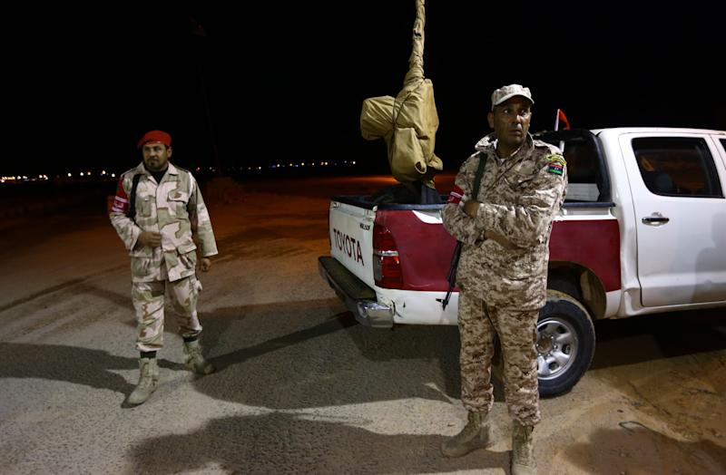 Fighters from the Fajr Libya stand guard on February 18, 2015 at a mobile checkpoint at the western entrance of the Mediterranean city of Sirte, Libya (AFP Photo/Mahmud Turkia)