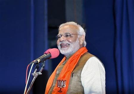 Modi, who will be the next prime minister of India, smiles as he addresses Gujarat state lawmakers and party workers during the appointment of the state's new chief minister in Gandhinagar