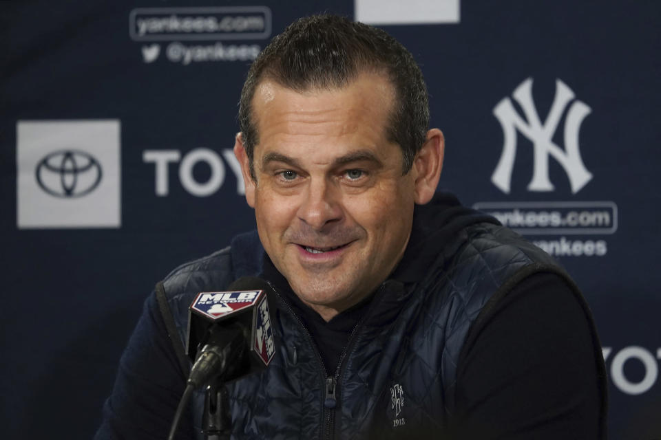 New York Yankees manager Aaron Boone responds to a question during a news conference at the American League Wild Card Workout Day at Fenway Park, Monday, Oct. 4, 2021, before Tuesday's American League Wild Card game against the Boston Red Sox in Boston. (AP Photo/Mary Schwalm)