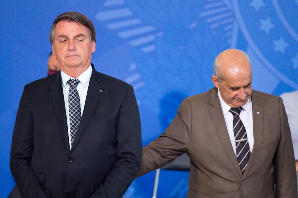 BRASILIA, BRAZIL - OCTOBER 28: Jair Bolsonaro, President of Brazil, and Head of the Secretariat of Government of the Presidency Luiz Eduardo Ramos during Civil Servant Day Ceremony amidst the coronavirus (COVID-19) pandemic at the Planalto Palace on October 28, 2020 in Brasilia. Brazil has over 5.439,000 confirmed positive cases of Coronavirus and more than 157,000 deaths. (Photo by Andressa Anholete/Getty Images)