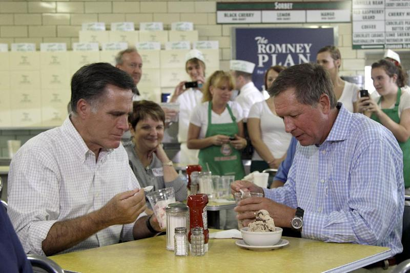 Republican presidential candidate, former Massachusetts Gov. Mitt Romney, eats ice cream with Ohio Gov. John Kasich, Tuesday, Aug. 14, 2012 at Tom's ice cream in Zanesville, Ohio. (AP Photo/Mary Altaffer)