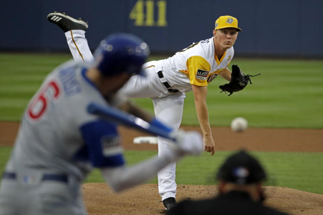 Pittsburgh Pirates starting pitcher Mitch Keller, top right, delivers to Chicago Cubs' Nicholas Castellanos during the first inning of the Little League Classic baseball game at Bowman Stadium in Williamsport, Pa., Sunday, Aug. 18, 2019. Castellanos hit the pitch for a solo home run. (AP Photo/Gene J. Puskar)