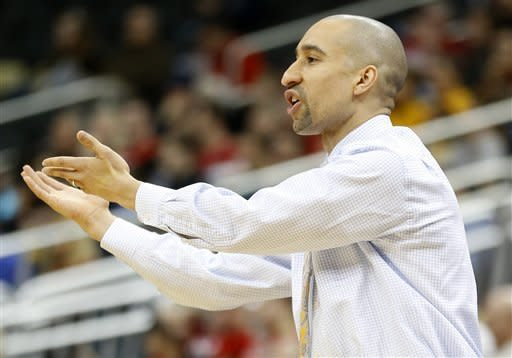 Virginia Commonwealth coach Shaka Smart makes a point to an official in the second half of the NCAA college basketball game against Duquesne on Saturday, Jan. 19, 2013, in Pittsburgh. VCU won 90-63. (AP Photo/Keith Srakocic)