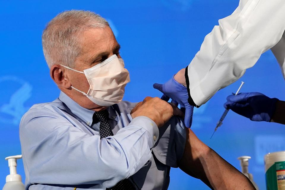Dr. Anthony Fauci, director of the National Institute of Allergy and Infectious Diseases, prepares to receive his first dose of the new Moderna COVID-19 vaccine at the National Institutes of Health, in Bethesda, U.S., December 22, 2020. Patrick Semansky/Pool via REUTERS