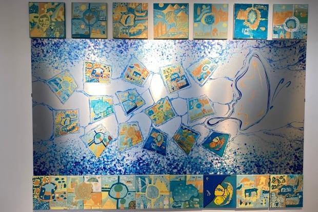 The mural was created by students in grades 3 and 4 at Viscount Alexander Public School as part of MASC's Awesome Arts program. It's now hanging at the Ottawa Art Gallery. (Michel Aspirot/CBC - image credit)
