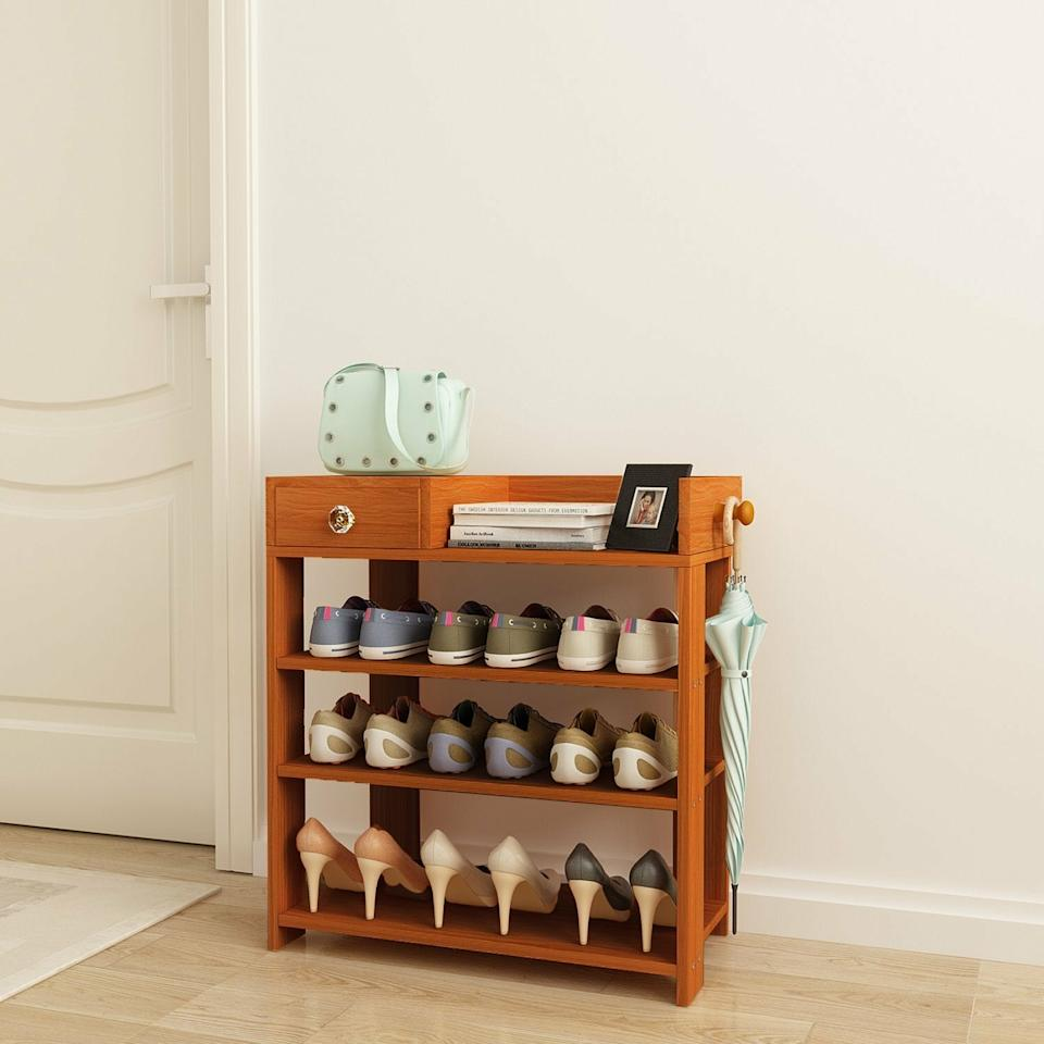 "<h3><a href=""https://www.wayfair.com/storage-organization/pdp/rebrilliant-12-pair-shoe-rack-rebr5146.html"" rel=""nofollow noopener"" target=""_blank"" data-ylk=""slk:Rebrilliant 12-Pair Shoe Rack"" class=""link rapid-noclick-resp"">Rebrilliant 12-Pair Shoe Rack</a></h3><br><strong>When ""coat closets"" are a foreign concept:</strong> Turn to a compact, free-standing entryway rack to hold your outerwear in maximized space-saving fashion.<br><br><strong>Rebrilliant</strong> 12 Pair Shoe Rack, $, available at <a href=""https://go.skimresources.com/?id=30283X879131&url=https%3A%2F%2Fwww.wayfair.com%2Fstorage-organization%2Fpdp%2Frebrilliant-12-pair-shoe-rack-rebr5146.html"" rel=""nofollow noopener"" target=""_blank"" data-ylk=""slk:Wayfair"" class=""link rapid-noclick-resp"">Wayfair</a>"