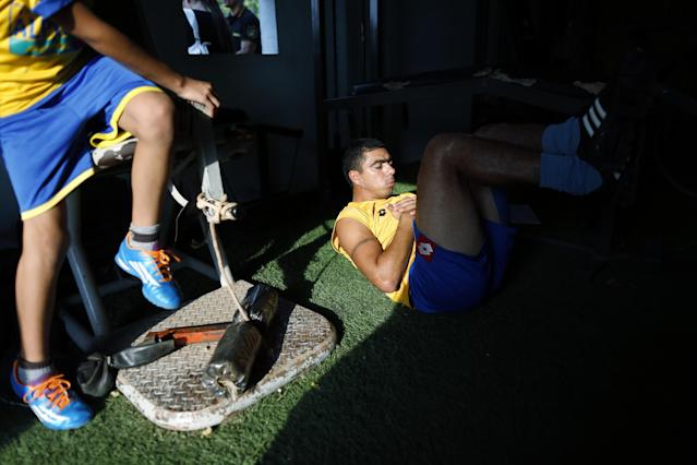 In this Oct. 18, 2014 photo, Deportivo Capiata soccer player Ricardo Ortiz exercises during a training session in Capiata, Paraguay. When Capiata, a soccer club formed six years ago beat Boca 1-0 at its famed La Bombonera stadium in Buenos Aires on Oct. 15, it was a shocker for the ages. (AP Photo/Jorge Saenz)