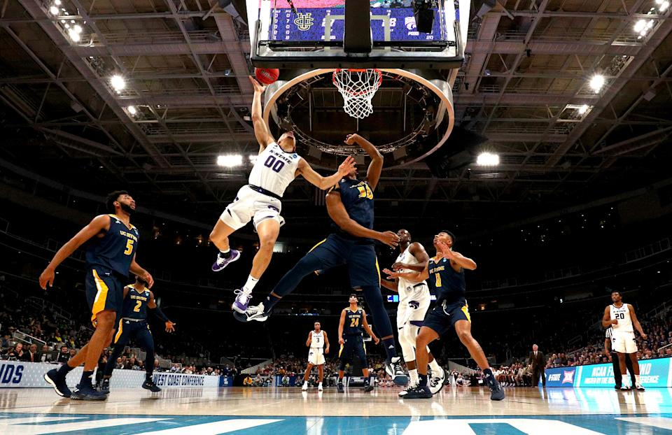 <p>Mike McGuirl #0 of the Kansas State Wildcats takes a shot against Elston Jones #50 of the UC Irvine Anteaters in the first half during the first round of the 2019 NCAA Men's Basketball Tournament at SAP Center on March 22, 2019 in San Jose, California. (Photo by Ezra Shaw/Getty Images) </p>