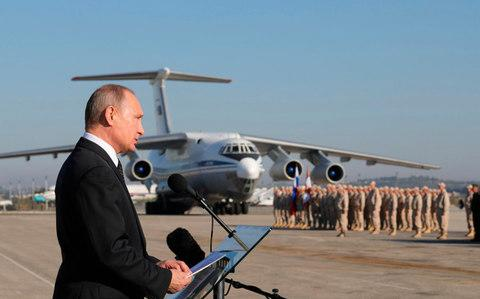 Vladimir Putin speaks to servicemen at Russia's airbase in Syria in December - Credit: Mikhail Klimentyev/Pool Photo via AP