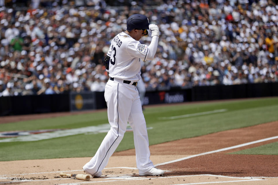 San Diego Padres' Manny Machado reacts after striking out during the first inning of a baseball game against the San Francisco Giants, Thursday, March 28, 2019, in San Diego. (AP Photo/Gregory Bull)