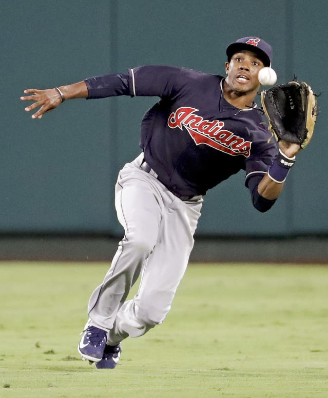 Cleveland Indians center fielder Greg Allen catches a fly ball hit by Los Angeles Angels' Andrelton Simmons during the eighth inning of a baseball game in Anaheim, Calif., Wednesday, Sept. 20, 2017. (AP Photo/Chris Carlson)