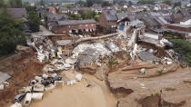 Debris of collapsed houses is pictured in the Blessem district of Erftstadt, Germany, Friday, July 16, 2021. Heavy rains caused mudslides and flooding in the western part of Germany. Multiple have died and dozens are missing as severe flooding in Germany and Belgium turned streams and streets into raging, debris-filled torrents that swept away cars and toppled houses. (David Young/dpa via AP)