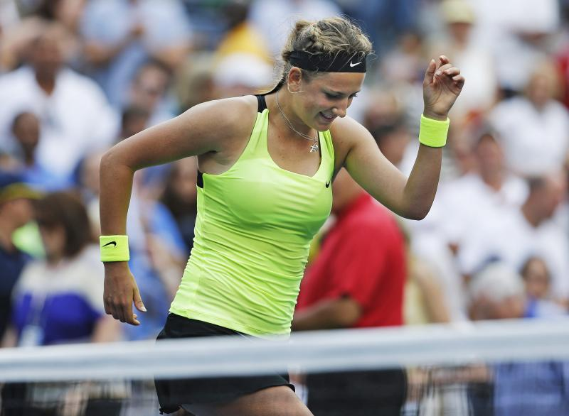 Victoria Azarenka, of Belarus, reacts after winning her match against Maria Sharapova, of Russia, during a semifinal match at the 2012 US Open tennis tournament,  Friday, Sept. 7, 2012, in New York. (AP Photo/Darron Cummings)