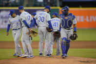 Kansas City Royals team members leave starting pitcher Danny Duffy (30) on the mound during the fifth inning of a baseball game against the Detroit Tigers, Wednesday, May 12, 2021, in Detroit. (AP Photo/Carlos Osorio)
