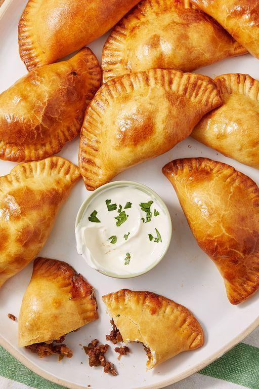 """<p>Empanadas are perfect little pockets of <a href=""""https://www.delish.com/uk/cooking/recipes/a29455944/cheesy-beef-quesadillas-recipe/"""" rel=""""nofollow noopener"""" target=""""_blank"""" data-ylk=""""slk:cheesy beef"""" class=""""link rapid-noclick-resp"""">cheesy beef</a>. The dough bakes (or air fries!) into a golden flaky crust that shatters beautifully. We filled ours with a classic beef mixture, but you could fill yours with chicken or even beans and rice for a vegetarian version.</p><p>Get the <a href=""""https://www.delish.com/uk/cooking/recipes/a32283786/beef-empanadas-recipe/"""" rel=""""nofollow noopener"""" target=""""_blank"""" data-ylk=""""slk:Cheesy Beef Empanadas"""" class=""""link rapid-noclick-resp"""">Cheesy Beef Empanadas</a> recipe.</p>"""