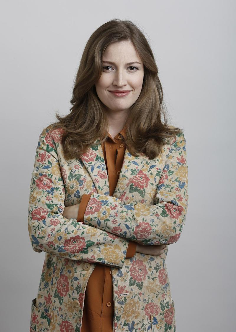 """In this June 18, 2012 photo, actress Kelly Macdonald poses for a portrait during the """"Brave"""" press day at Loews Hollywood Hotel, in Los Angeles. The top spot at the box office is rare turf for Kelly Macdonald, a character actress known on the big-screen mainly for supporting roles in such films as """"No Country for Old Men"""" and """"Finding Neverland.""""  With her wild red mane and her killer skills with sword and bow, Macdonald has become the latest in Hollywood's growing line of successful female action heroes. (Photo by Todd Williamson/Invision/AP)"""