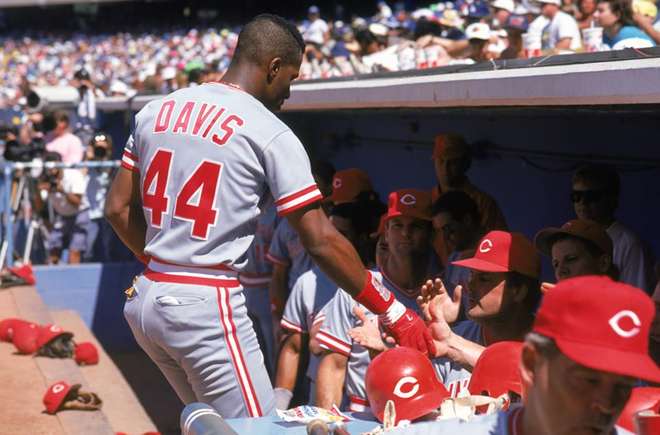 SEPTEMBER,1990: Eric Davis #44 of the Cincinnati Reds is congratulated as he enters the dugout during a September, 1990 season game. Eric Davis played for the Cincinnati Reds from 1984-1991. (Photo by: Andrew D. Bernstein/Getty Images)