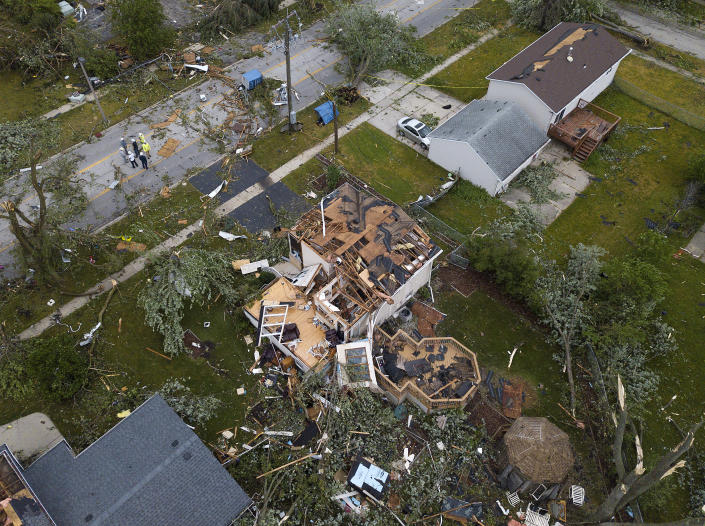 Debris litters the ground around damaged homes after a tornado ripped through the suburbs in Woodridge, Ill., Monday, June 21, 2021. (Mark Welsh/Daily Herald via AP)