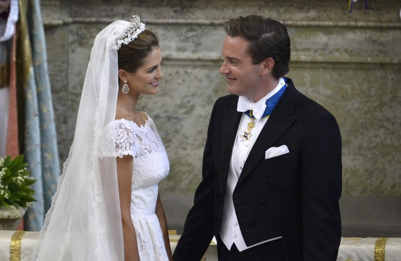 Princess Madeleine of Sweden and Christopher O'Neill smile during their wedding ceremony at the Royal Chapel in Stockholm, Saturday June 8, 2013. (AP Photo/Anders Wiklund) SWEDEN OUT